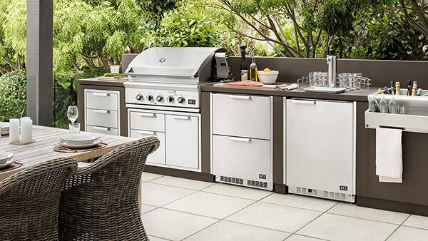 Lineup of DCS outdoor kitchen appliances range