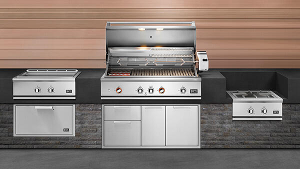 Front view of matching DCS stainless steel appliances at outdoor kitchen