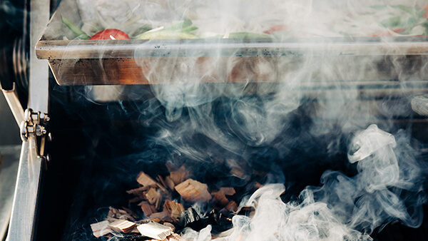 Close up of smoke wood chips on DCS grilll
